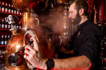Distiller Freddy checking the distillates