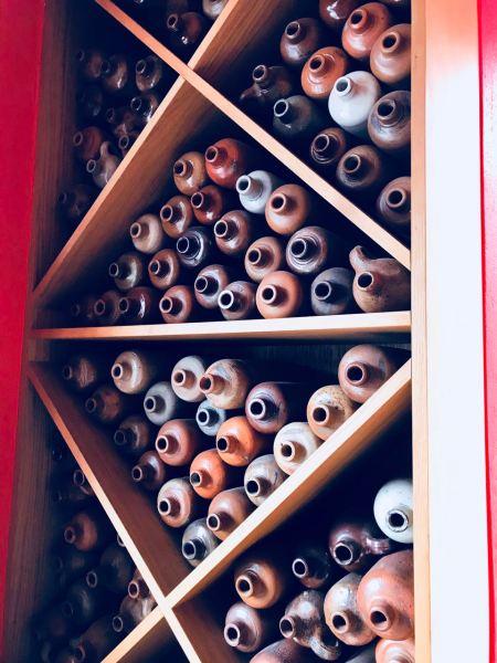 Old jars used as wall decoration at Jopenkerk Hoofddorp